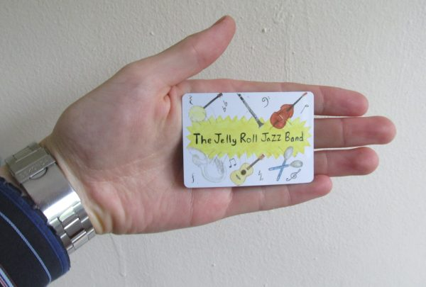 The Jelly Roll Jazz Band fridge magnet, with hand.